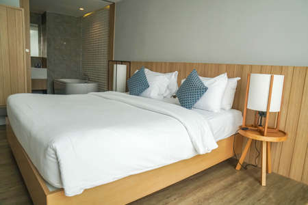 Huahin Thailand - February 2021: minimal double bed white mattress with Jacuzzi tub in luxury hotel bedroom