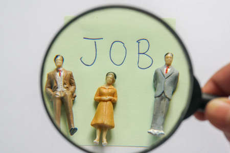 Human Resources concept - use magnifying glass to find the right man on the right job Stock Photo