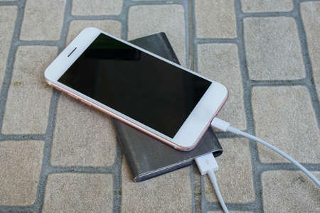 top view smartphone charge battery from power bank