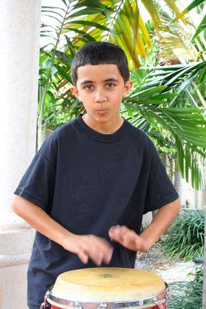 rythm: Child keeping rythm with a conga drum