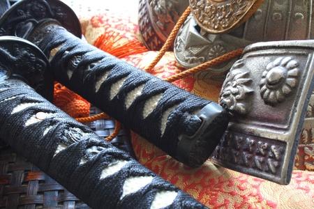 Samurai swords and warrior helmet, close up angle composition photo