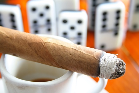 Cigar, espresso coffee and dominoes on the background photo