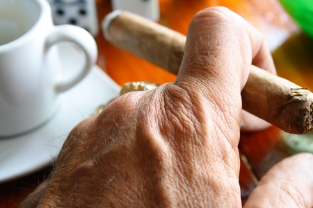 Hand with cigar and espresso cup on domino game Stock Photo - 12144138