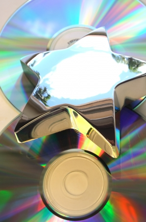 Reflecting metal star in top of compact disks photo