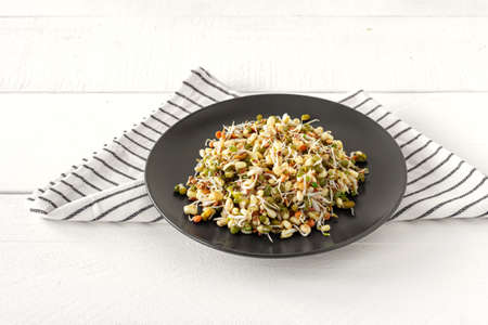 Salad made of sprouted beans served on a plate. Healthy raw food. Macrobiotics. Archivio Fotografico