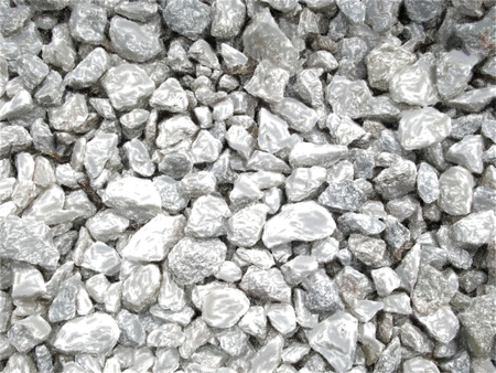 Small white and gray pebbles mixed with dry leaves and sprigs. Diffuse of marbledly in general terms. Texture artistic drawing. Pastel detailed style.