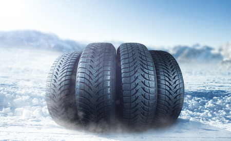 Winter tires on a snow cover Stock Photo