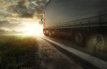 Truck at sunset on the road
