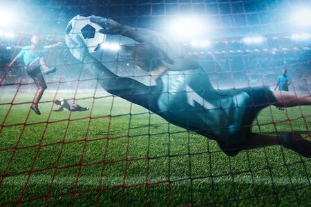 Goalkeeper holds a ball