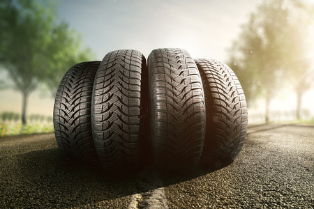 Summer car tires on the street Banque d'images
