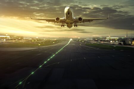 Airplane landing on sunrise