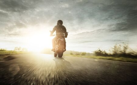 Motorcycle full speed at Sunrise