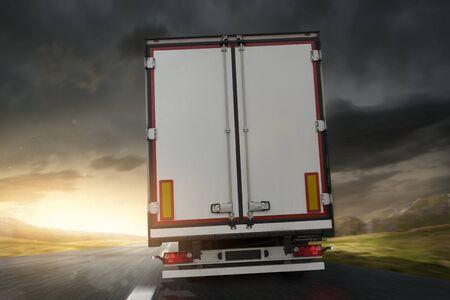 Truck at sunrise on the road 版權商用圖片 - 130136942