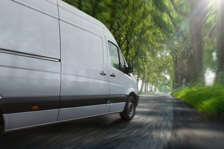 Delivery van on a country road 写真素材