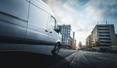 Delivery van delivers quickly in a city