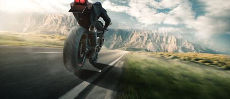 Motorcycle on a country road Stock Photo