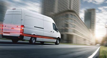 Delivery van delivers quickly in city 免版税图像