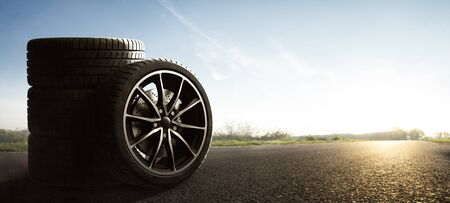 Car tire on the summer road