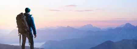 Hikers at sunrise on a mountain top