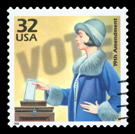 UNITED STATES OF AMERICA, CIRCA 1998: a postage stamp printed in USA showing an image of a woman voting about the 19th amendment to the US Constitution allowing women to vote, CIRCA 1998. Publikacyjne