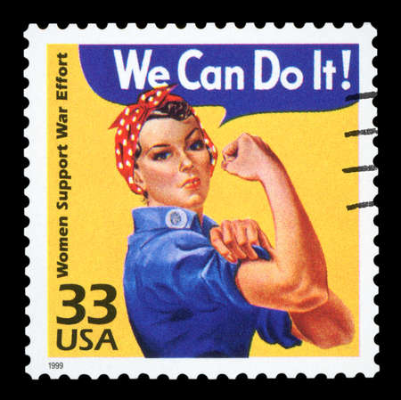 Canceled US Postage stamp showing an image of Rosie The Riveter commemorating the American woman who worked in factories during the World War II, circa 1999.