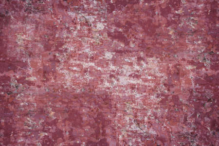 Concrete texture - close-up of a fragment of an old concrete wall with remnants of red paint