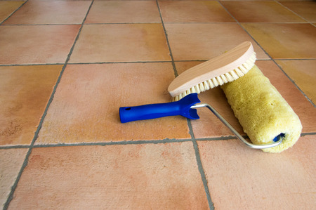 whitewash: Paint whitewash, accessories, tools, brush, roll on rustic floor - closeup