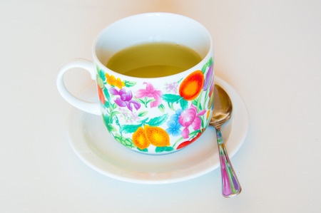 remedial: Mallow herbal tea cup on orange background Stock Photo