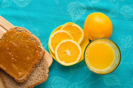 Good morning with orange juice, bread and jam