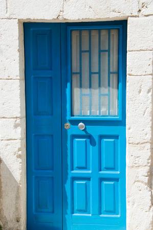doorhandle: Blue door in town near sea Stock Photo