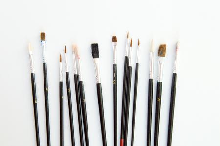 closeup: Illustrator paintbrushes on white background closeup Stock Photo