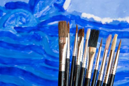 paintbrushes: Illustrator paintbrushes on watercolor draw background Stock Photo