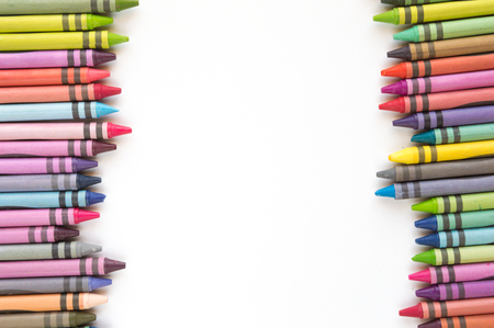 lined up: Crayons and pastels lined up in rainbow isolated on white background.
