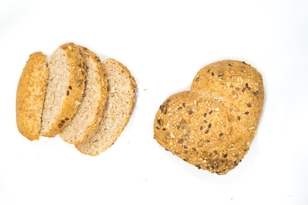 wholegrain mustard: Love for wholemeal bread with seeds of sesame, mustard and sunflower on white background