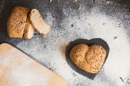 wholegrain mustard: Heart shape of wholemeal bread on blackboard backround