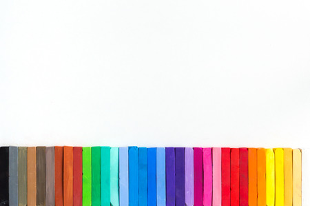 lined up: Colorful chalks lined up on white background isolated Stock Photo