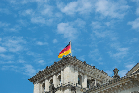 at close quarters: Close-up of German flag on famous Reichstag building, seat of the German Parliament (Deutscher Bundestag), travel in Berlin