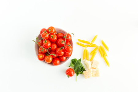 close up food: Italian red tomatoes close up food with pasta, basil leafs, cheese, isolated on white background - Top view
