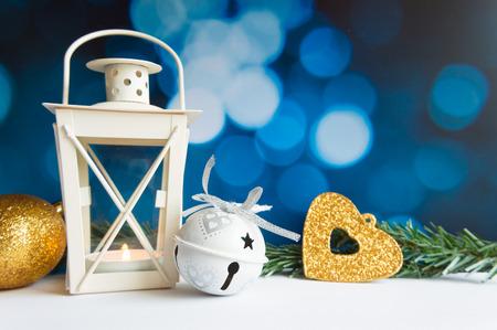 Christmas ball tree and lantern on blue bokeh light background Stock Photo