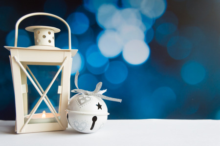 Christmas ball tree and lantern on blue bokeh light background Stock Photo