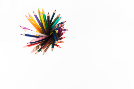 Mockups for artwork with colorful crayons and pastels. Top view. Artistic work tools on white wooden table.