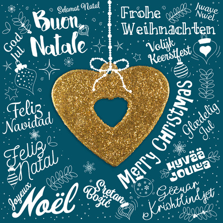 Merry Christmas greetings card from world in different languages with golden heart, calligraphic text and font handwritten lettering