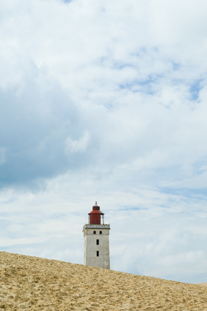 Lighthouse Rubjerg Knude and sand dunes at the danish North Sea coast, vintage style, Denmark, Europe