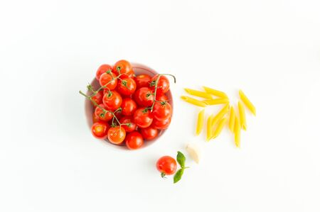 Italian red tomatoes close up food with pasta, basil leafs, cheese, isolated on white background - Top view