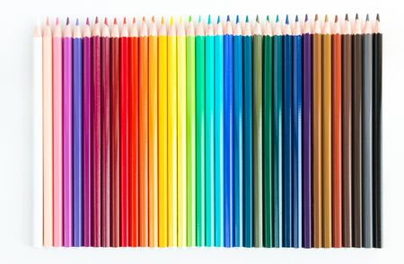 Crayons and watercolor pastels lined up isolated on white background Standard-Bild