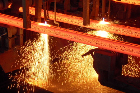 red hot iron: Hot steel billets in a continuous caster production at cutting torch