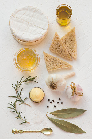 Roasted Garlic Ingredients with Fresh Camembert and Bread photo