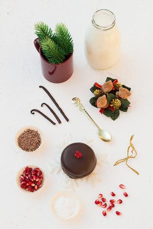 Christmas Mini Chocolate Cake with Pomegranate Seeds and Milk photo