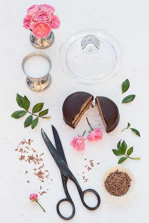 Mini Chocolate Cake with Milk and Roses photo