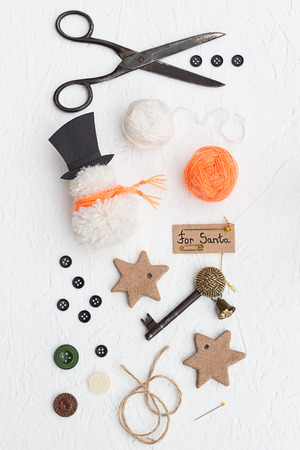 Yarn, Buttons and Pins Key for Santa Claus Decoration Set photo